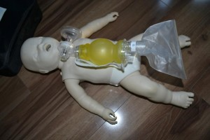 Pediatric training mannequin and bag valve mask